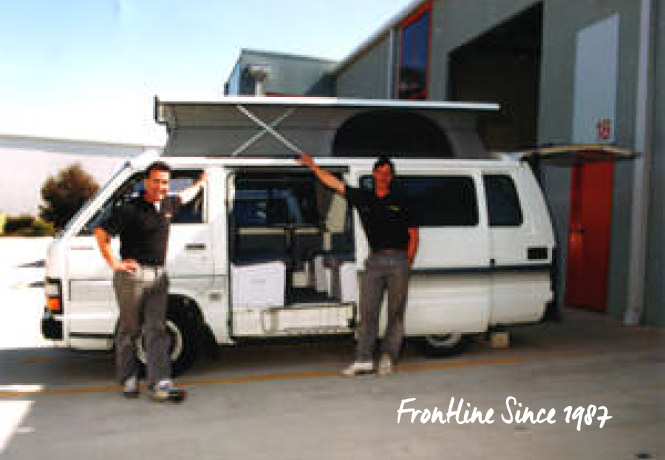 Frontline Camper Conversions Directors standing with Retro Toyota Hiace Campervan 1987