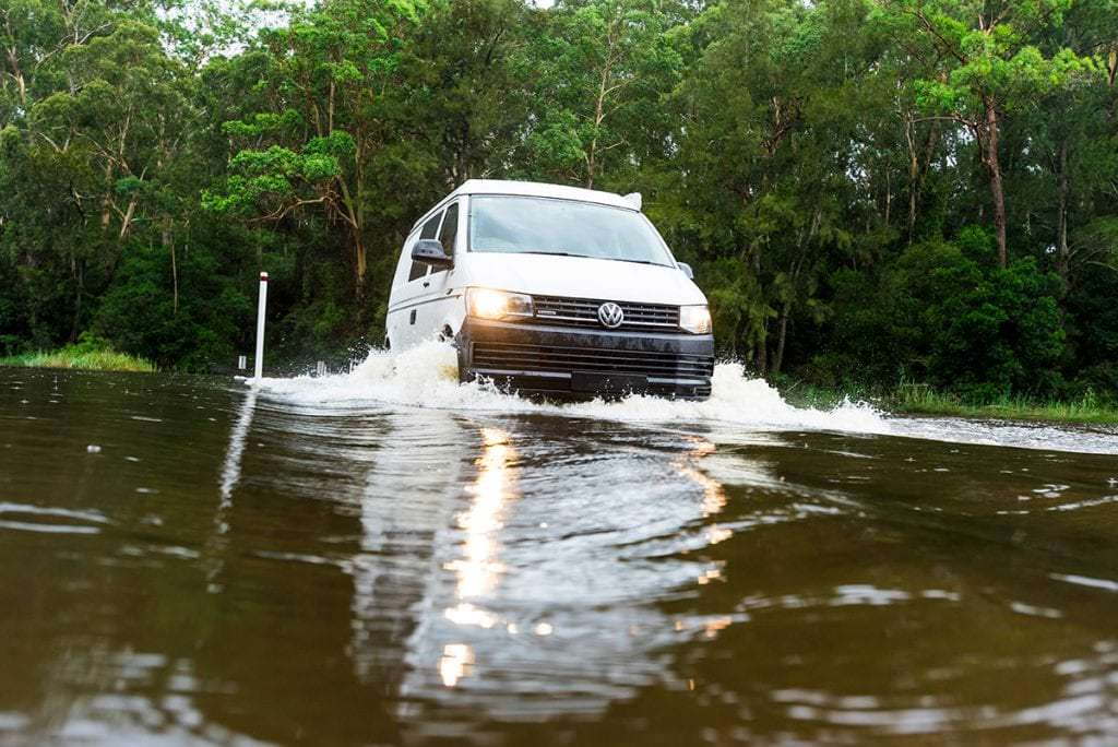 VW T6 Transporter Frontline Campervan drivng through flooded road